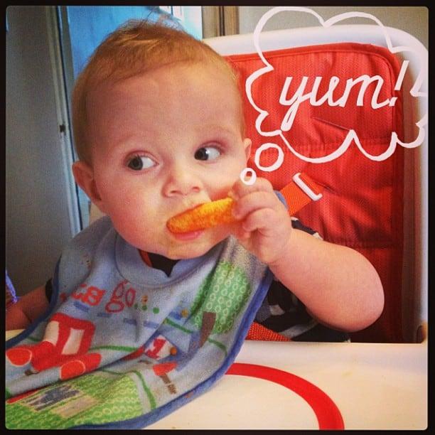 baby eating carrot sticks