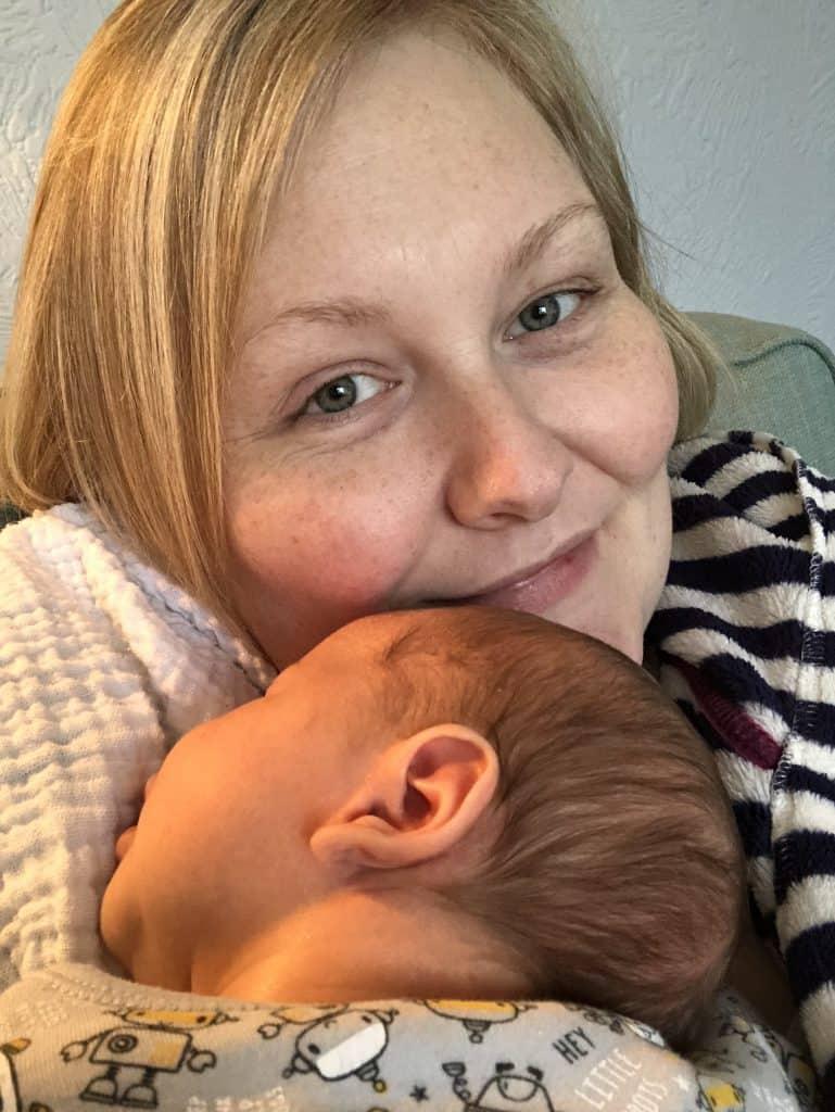 Baby snuggles Freddie