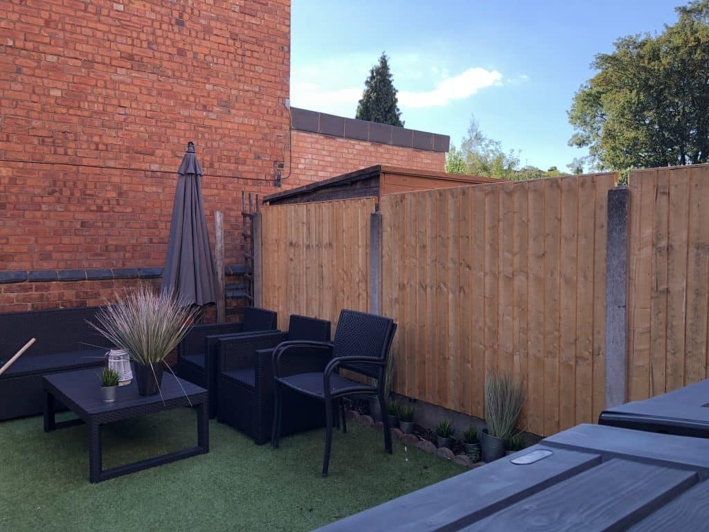 AFTER WITH NEW FENCE PANELS