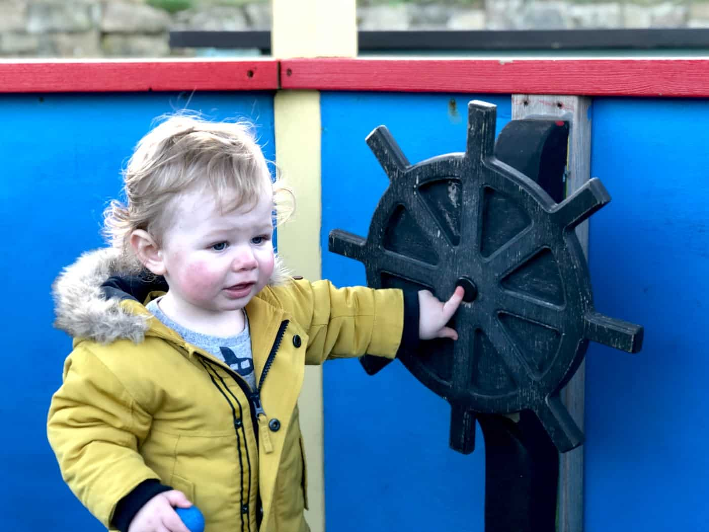 Boy on wooden pirate ship